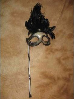 Vénitien noir à plumes sur bâton